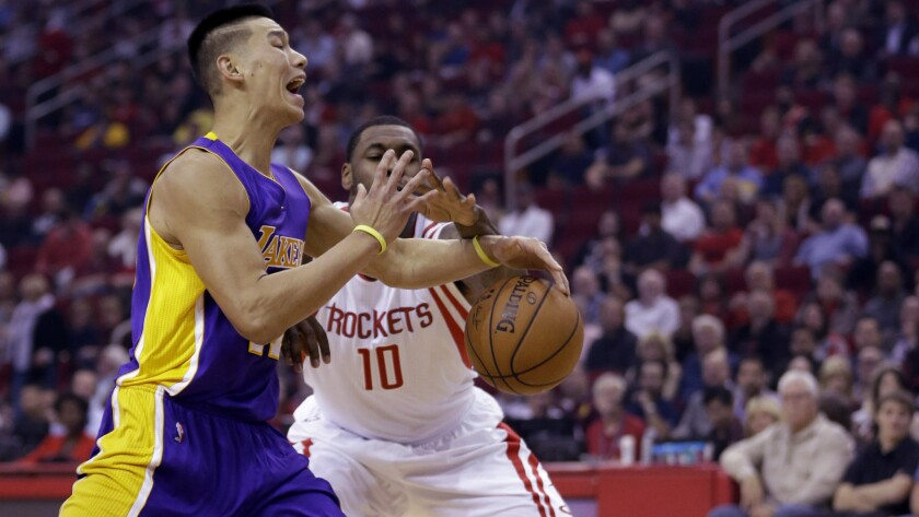 As part of the trade to acquire Jeremy Lin, left, last year, the Lakers will receive the Houston Rockets' first-round pick in the 2015 NBA draft.