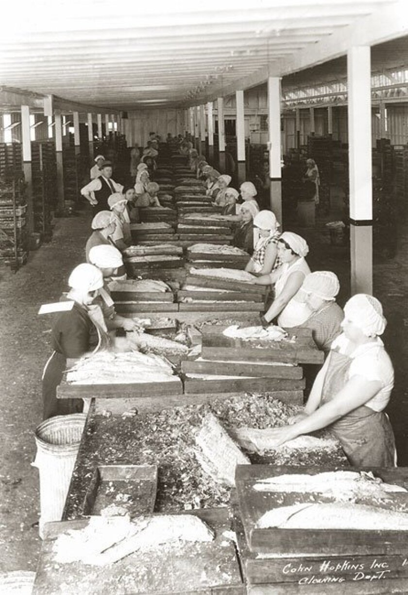 """Workers in 1931 cleaned tuna at the Cohn-Hopkins Co. on Crosby Street in San Diego. The city was once called the """"tuna capital."""" (Courtesy of San Diego Public Library)"""