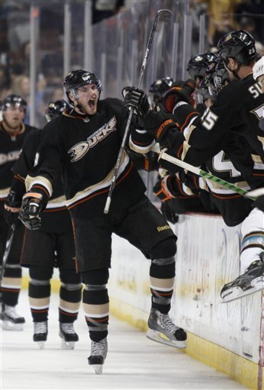 Anaheim Ducks right wing Bobby Ryan (9) celebrates his goal against the San Jose Sharks in the second period of a NHL hockey game in Anaheim, Calif., Sunday, Jan. 9, 2011. (AP Photo/Lori Shepler)
