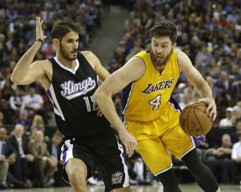 Lakers forward Ryan Kelly drives against Kings forward Omri Casspi during the first half on Monday.