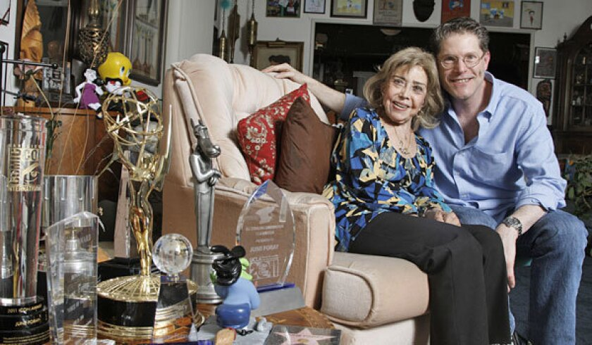 June Foray and Bob Bergen in the awards and memorabilia-filled living room of Foray's home.