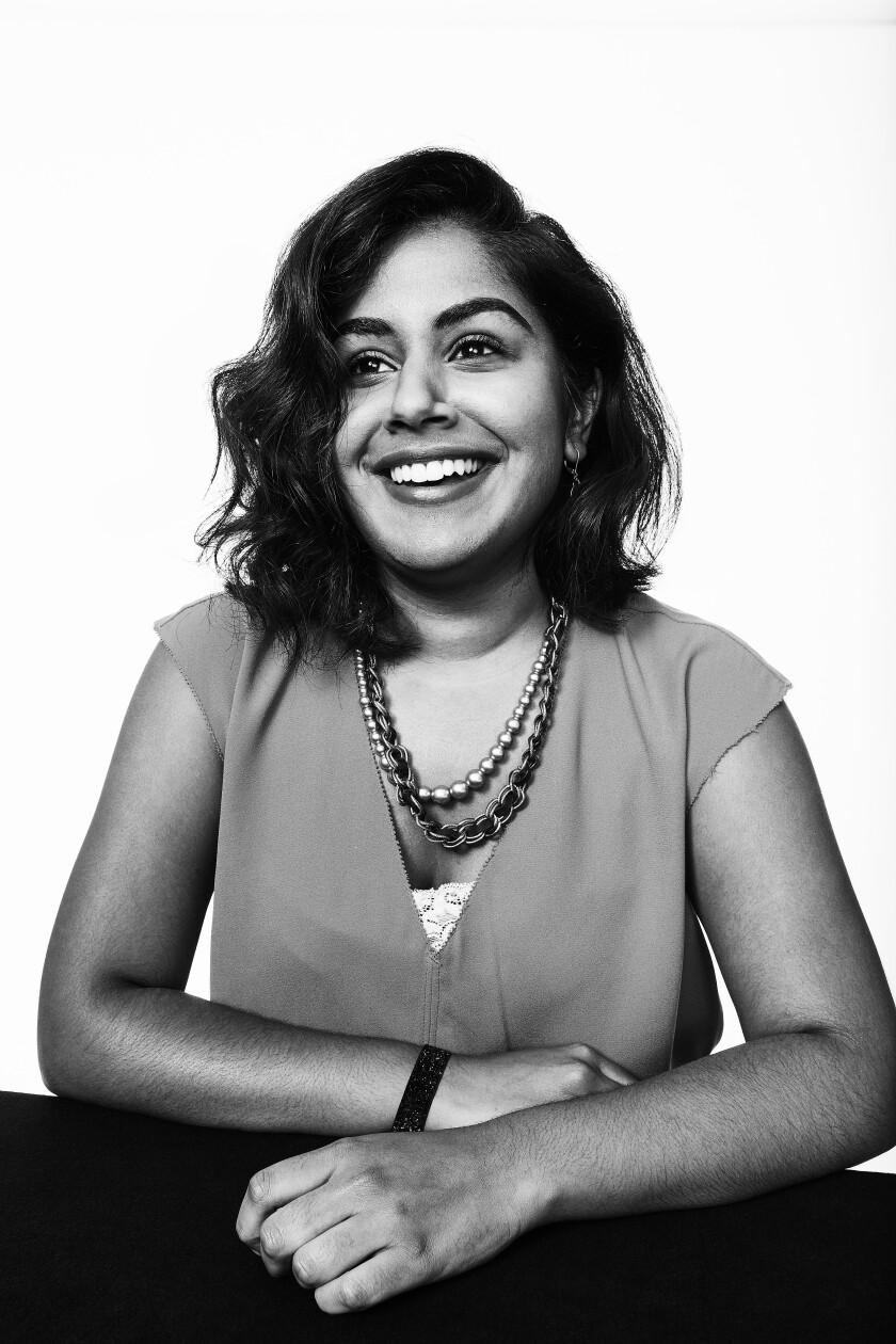 A photo portrait of a smiling Elena Gooray.