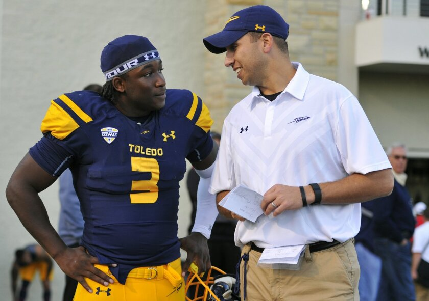 FILE - In this Oct. 24 2015, file photo, Toledo running back Kareem Hunt (3) talks with head coach Matt Campbell after a 38-7 win over Kent State in an NCAA college football game in Toledo, Ohio. Campbell grew up in Massillon, the son of a coach. Campbell played at Perry High School for coach Keith