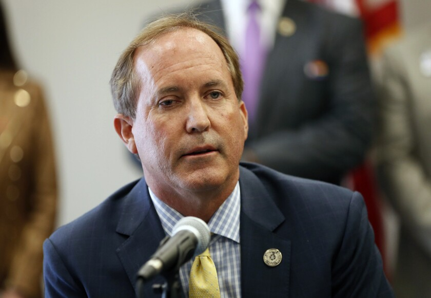 """Texas Attorney General Ken Paxton speaks at the Austin Police Association on Thursday Sept. 10, 2020. Twitter has filed a lawsuit against the Texas Attorney General. The social media company claims the Republican used his office to retaliate against it for banning the account of former President Donald Trump following the riot at the U.S. Capitol last year. Days after the deadly riot, Paxton announced an investigation into Twitter and four other major technology companies for what he called """"the seemingly coordinated de-platforming of the president."""" Twitter responded Monday, March 8, 2021 with a federal lawsuit claiming Paxton is seeking to punish it for taking Trump's account offline. (Jay Janner/Austin American-Statesman via AP)"""