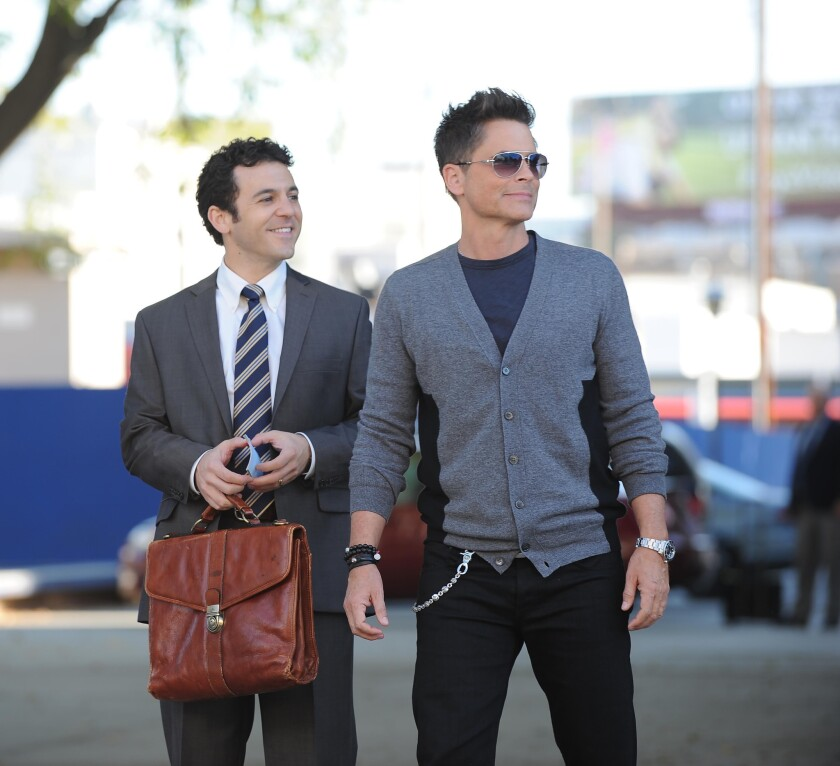 """Fred Savage and Rob Lowe avoided being expelled from Marshall High when the school district allowed filming of their new show, """"The Grinder,"""" to continue."""