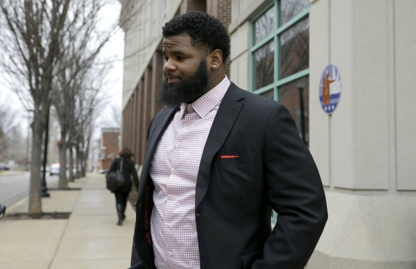 New York Jets NFL football player Sheldon Richardson walks out of the St. Charles County Courthouse, Tuesday, Jan. 26, 2016, in St. Charles, Mo., after pleading guilty to reduced charges connected to a recent high-speed police chase. Richardson was sentenced to two years of probation and community service after his July 2015 arrest for driving a Bentley Silver Spur at 143 mph on an interstate highway near his offseason home in suburban St. Louis. (AP Photo/Jeff Roberson)