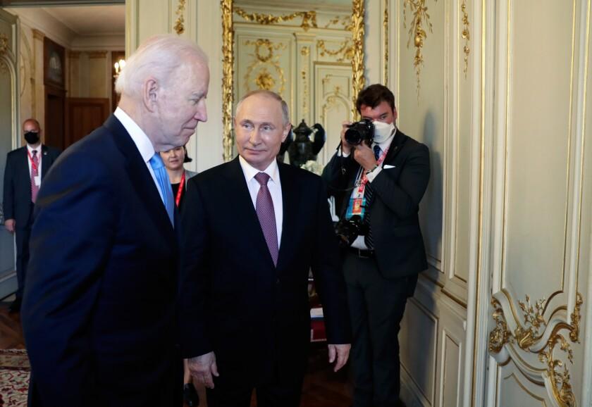U.S President Joe Biden, left, and Russian President Vladimir Putin walk in a hall during their meeting at the 'Villa la Grange' in Geneva, Switzerland in Geneva, Switzerland, Wednesday, June 16, 2021. (Mikhail Metzel/Pool Photo via AP)