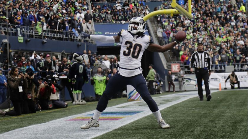 Rams running back Todd Gurley (30) gets ready to spike the ball after scoring one of his three rushing touchdowns against the Seattle Seahawks.