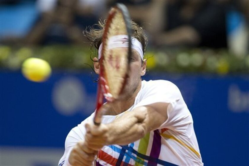 Argentina's David Nalbandian returns the ball to Spain's Nicolas Almagro during a Brazil Open ATP tournament tennis match in Sao Paulo, Brazil, Friday, Feb. 15, 2013. (AP Photo/Andre Penner)