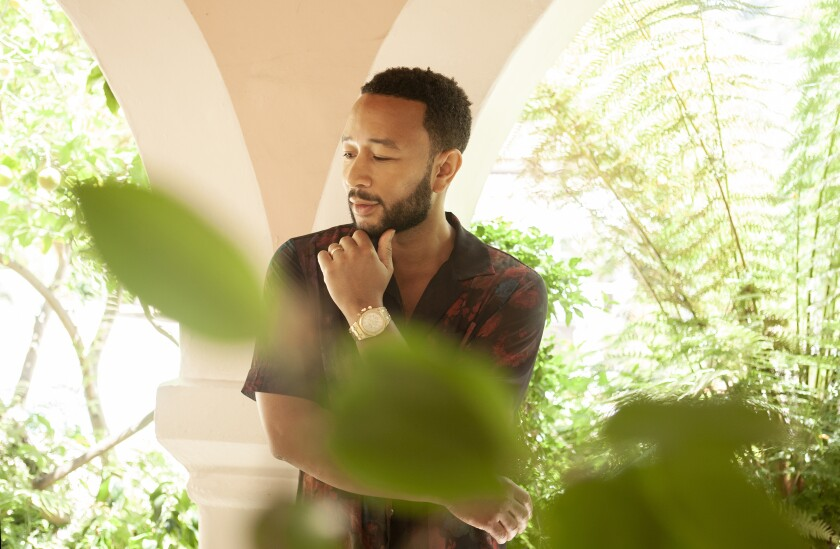 "In this June 13, 2020 photo, singer-songwriter John Legend appears during a photo session at The Bel Air Hotel in Beverly Hills, Calif., to promote his latest album ""Bigger Love."" (Photo by Rebecca Cabage/Invision/AP)"
