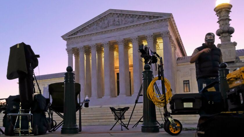 News crews set up outside the Supreme Court early Monday on the first day of the court's new term.