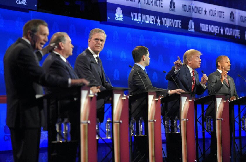 FILE - In this Oct. 28, 2015, Republican presidential candidate, from left, Ohio Gov. John Kasich, former Arkansas Gov. Mike Huckabee, former Florida Gov. Jeb Bush, Sen. Marco Rubio, R-Fla., Donald Trump and Ben Carson, participate in a debate in Boulder, Colo. Despite a handful of high-profile def