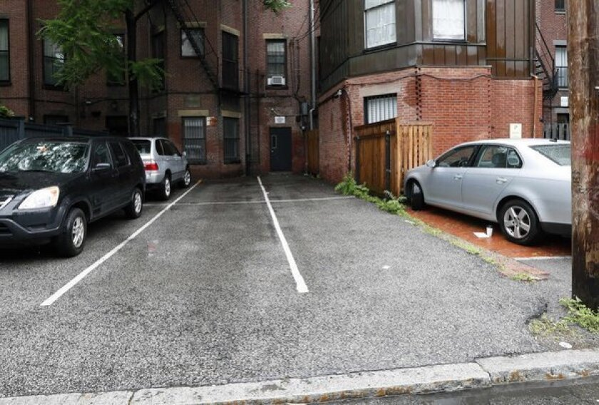 Bidder snags two Boston parking spots for $560,000. Priceless.