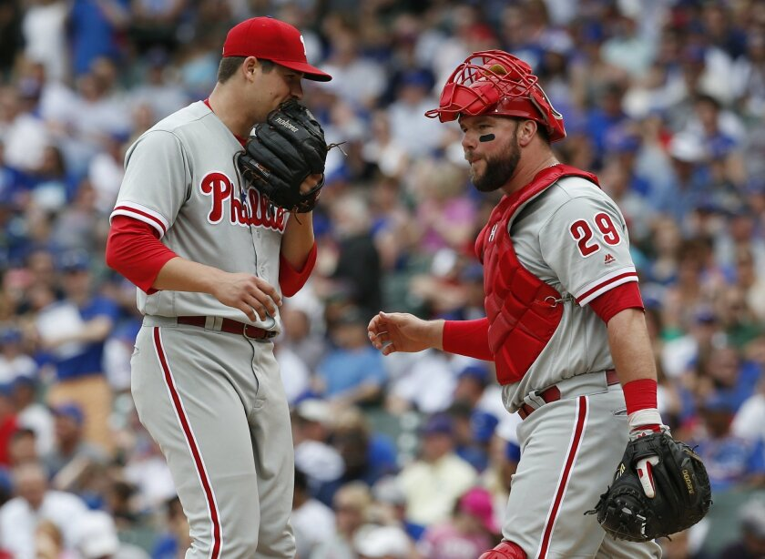 Philadelphia Phillies starter Jerad Eickhoff, left, talks with catcher Cameron Rupp during the first inning of a baseball game against the Chicago Cubs Saturday, May 28, 2016, in Chicago. (AP Photo/Nam Y. Huh)