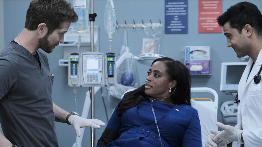 """Matt Czuchry,  Nichelle Hines and Manish Dayal in a hospital setting in a scene from  """"The Resident"""""""