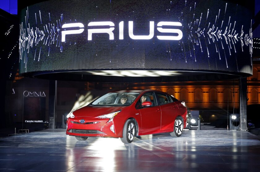 Toyota unveils the latest version of the Prius at an event Tuesday, Sept. 8, 2015, in Las Vegas. The car is still the No. 1 hybrid on the market, but has been a tougher sell for dealers with gas prices below $3 in many areas of the country.