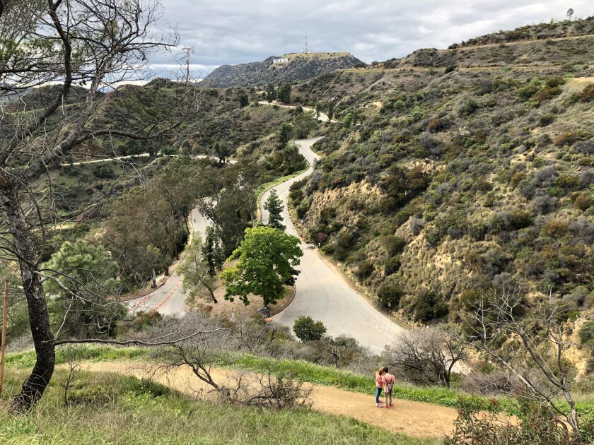 Griffith Park's trails were due to reopen Saturday morning after a closure of more than a month. Hikers must wear face coverings and keep their distance. Photo shot in late March.
