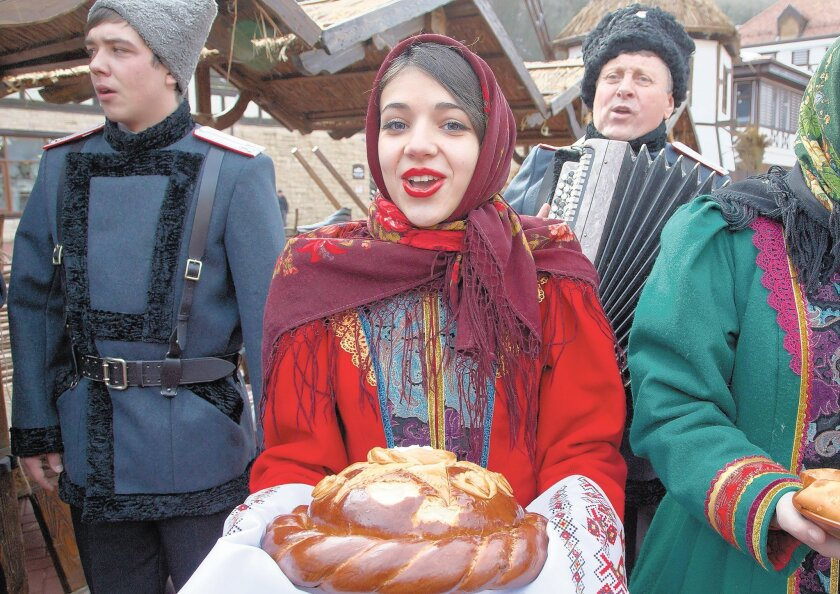 Artists in folk costumes welcome guests to Rosa Khutor (about 30 miles from Sochi), where skiing and snowboarding events will be held.