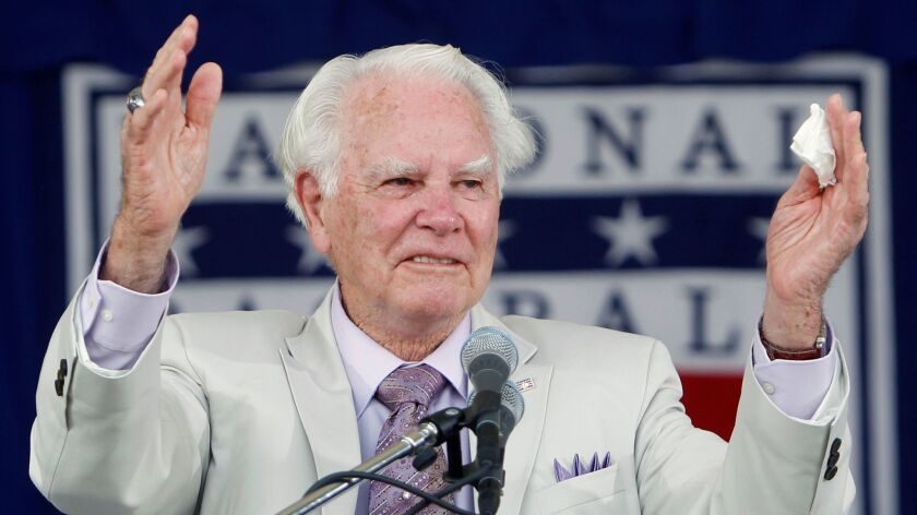 Late umpire Doug Harvey appears at the Baseball Hall of Fame in Cooperstown, N.Y. during his induction in 2010. Harvey, one of 10 umpires enshrined in the hall, died Saturday at 87.