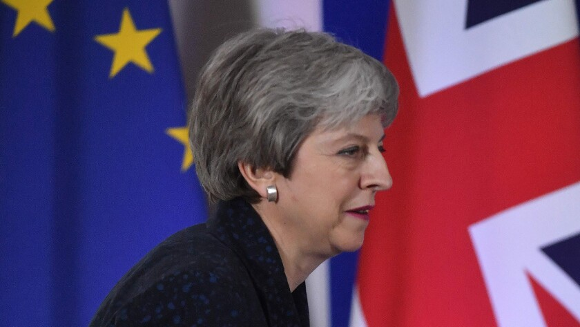 British Prime Minister Theresa May arrives at a news conference Friday in Brussels.