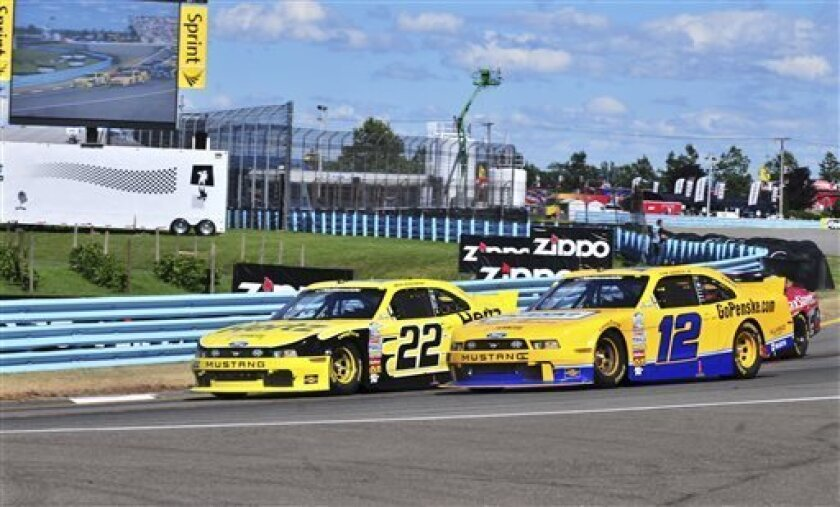 Brad Keselowski (22) leads Sam Hornish Jr. (12) during the NASCAR Nationwide Series auto race, Saturday, Aug. 10, 2013, in Watkins Glen, N.Y. Keselowski won, with Hornish second. (AP Photo/Charles Berch)