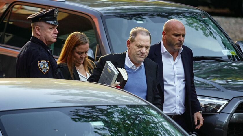 Harvey Weinstein arrives at the first precinct while turning himself to authorities following allega