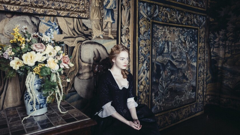 """""""She's so sassy and salty,"""" director Yorgos Lanthimos of Emma Stone, who costars in his film """"The Favourite,"""" set in the 18th century court of Queen Anne."""