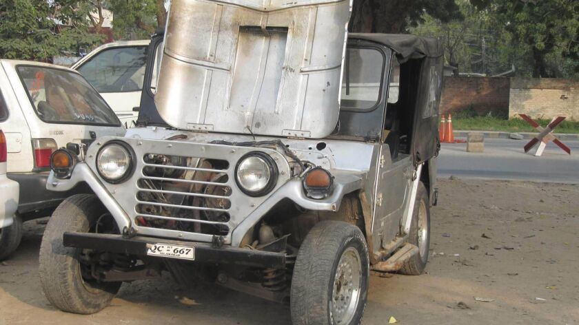 Correspondent Umar Farooq's secondhand M151 jeep at a mechanic's workshop in Lahore, Pakistan.