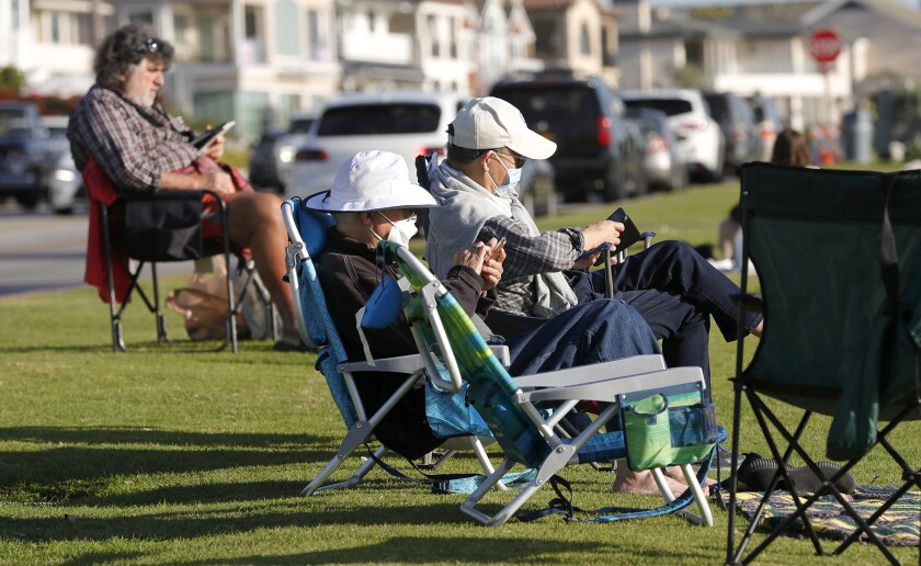 People enjoy the outdoors along Ocean Boulevard in Newport Beach on Friday.