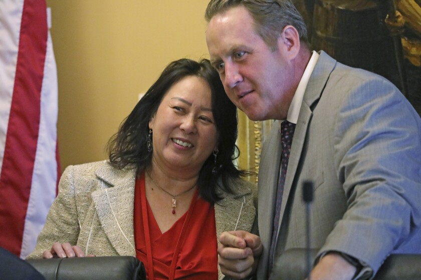 In this Monday, Sept. 16, 2019, photo, Rep. Karen Kwan and Rep. Jefferson Moss speak during a committee hearing at the Utah State Capitol, in Salt Lake City. Utah is the latest of nearly two dozen states across the country that are spending millions of their own money to make sure residents fill out next year's census form amid fears that undercounting could mean losing federal funding or crucial seats in Congress. (AP Photo/Rick Bowmer)