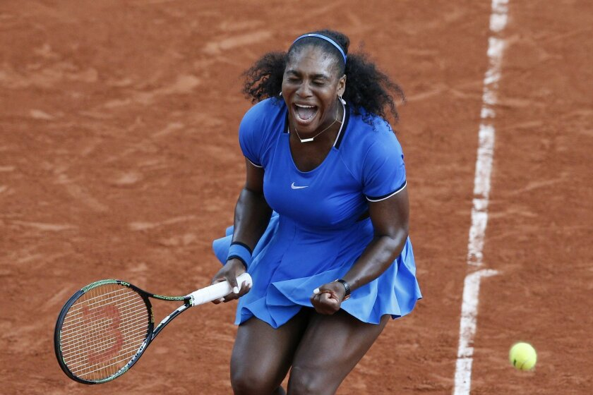Serena Williams of the U.S. clenches her fist in the third round match of the French Open tennis tournament against France's Kristina Mladenovic at the Roland Garros stadium in Paris, France, Saturday, May 28, 2016. (AP Photo/Christophe Ena)