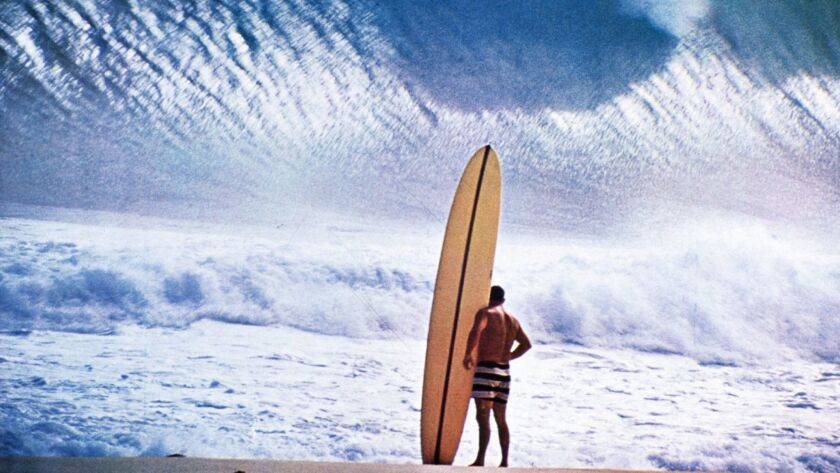 Surfer and filmmaker Greg Noll stares down Hawaii's Pipeline surf reef break in 1964.