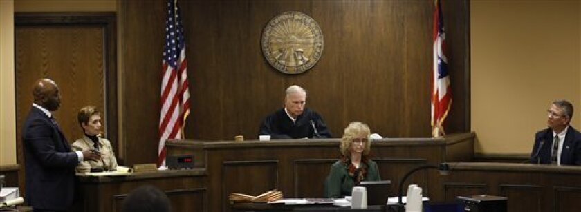 Defense attorney Walter Madison, left, cross examines Bureau of Criminal Investigation Special Agent Ed Lulla during a night session in the rape trial of Trent Mays, 17, and16-year-old Ma'lik Richmond in juvenile court on Thursday, March 14, 2013 in Steubenville, Ohio. Mays and Richmond are accused