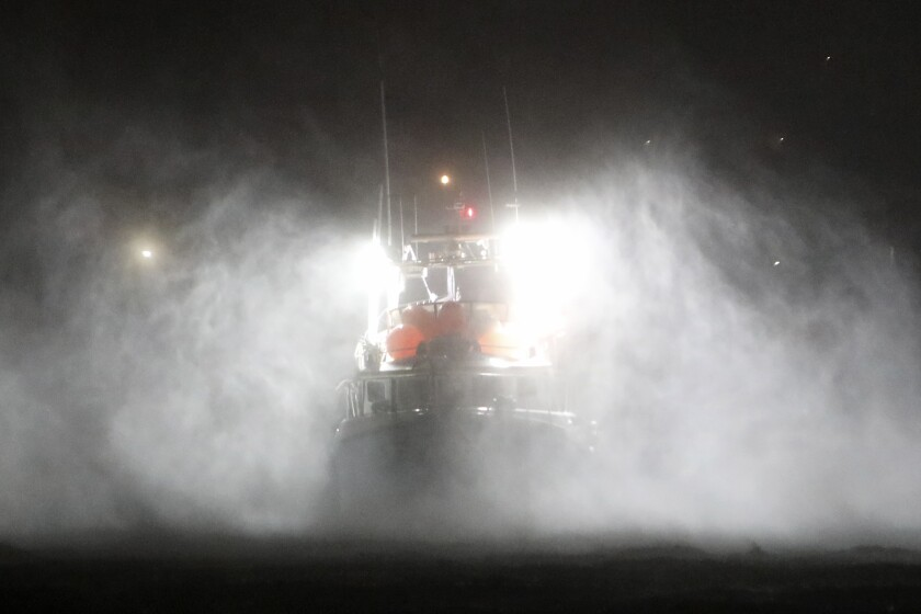 A fishing boat endures heavy rain and strong winds while moored at the port in Horta, in the Portuguese island of Faial, Wednesday, Oct. 2, 2019. Hurricane Lorenzo is lashing the mid-Atlantic Azores Islands with heavy rain, powerful winds and high waves. The Category 2 hurricane passed the Portuguese island chain Wednesday. (AP Photo/Joao Henriques)