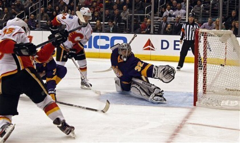 Calgary Flames left winger Mike Cammalleri (13) shoots and scores on Los Angeles Kings goalie Jonathan Quick (32) in the first period of an NHL hockey game in Los Angeles Saturday, March 9, 2013. (AP Photo/Reed Saxon)