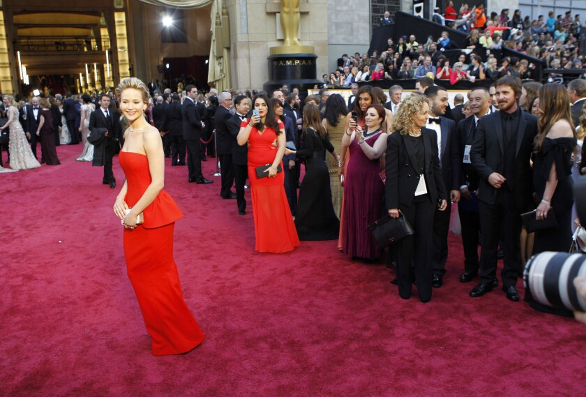 Jennifer Lawrence arrives at the 86th Annual Academy Awards on Sunday, March 2, 2014 at the Dolby Theatre at Hollywood & Highland Center in Hollywood, CA. (Wally Skalij / Los Angeles Times)