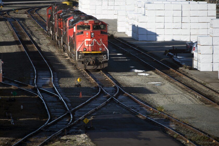 FILE - In this in this Nov. 20, 2019, file photo, a quiet Mclean Rail Yard in North Vancouver, British Columbia, is pictured, as Canadian National rail workers strike outside the gates. Canadian National has made its final pitch to regulators for preliminary approval of its $33.6 billion acquisition of Kansas City Southern railroad. The Canadian railroad reiterated its main arguments for the deal in a detailed filing with the Surface Transportation Board on Tuesday, July 6, 2021. (Jonathan Hayward/The Canadian Press via AP, File)