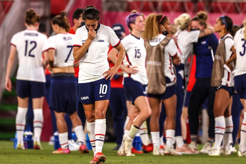 U.S. forward Carli Lloyd walks on the field after the team's semifinal loss to Canada at the Tokyo Olympics.
