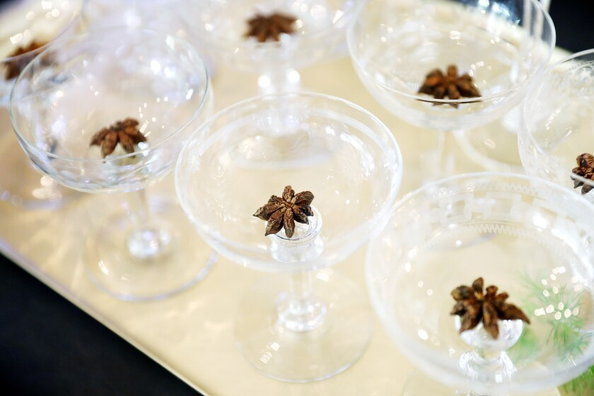 Add, flavor, texture and color by dropping star anise pods into glasses.