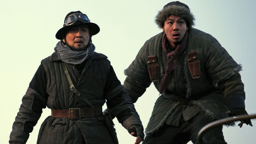 """Jackie Chan, left, and Alan Ng in the 1940s-set film """"Railroad Tigers."""""""
