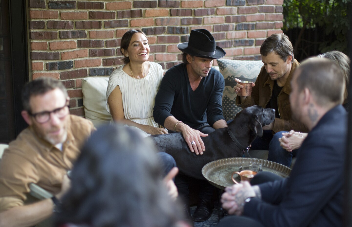 Actor Walton Goggins and wife Nadia Conners, left, entertain guests, including singer-songwriter Sturgill Simpson, right, at their Hollywood home.