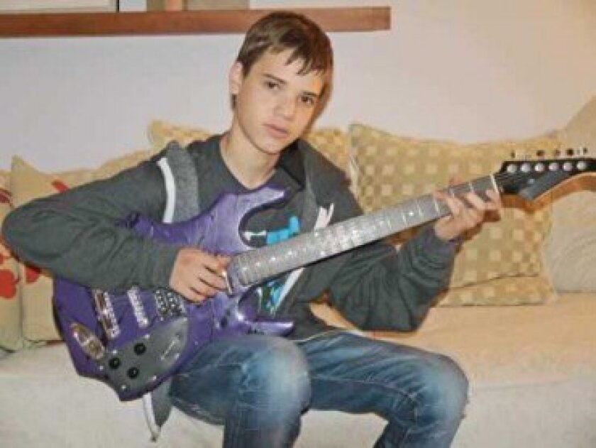 Jonah Kohn, 14, with the guitar he built that helped inspire his award-winning science project.  Courtesy