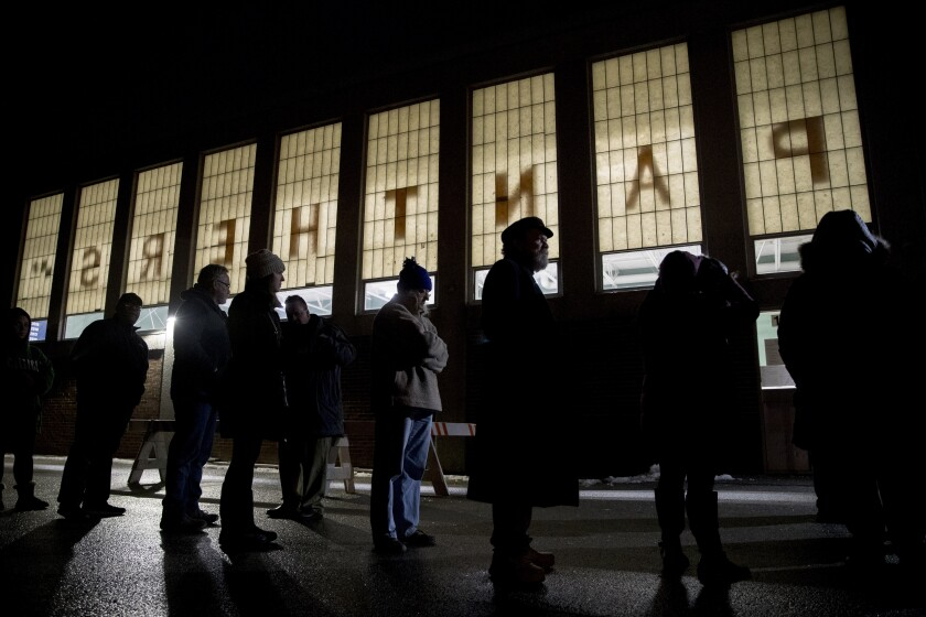 New Hampshire primary voters wait for their voting precinct to open outside Parker-Varney Elementary School, Tuesday, Feb. 11, 2020, in Manchester, N.H. (AP Photo/Andrew Harnik)