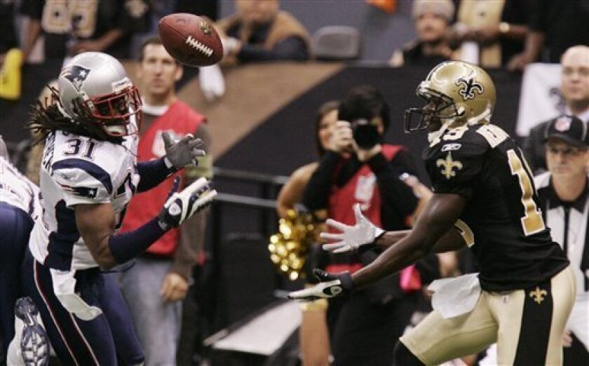 New Orleans Saints Devery Henderson (19) can't handle a pass while being defended by New England Patriots Brandon Meriweather (31) during the first quarter of an NFL football game, Monday, Nov. 30, 2009, in New Orleans. (AP Photo/Patrick Semansky)