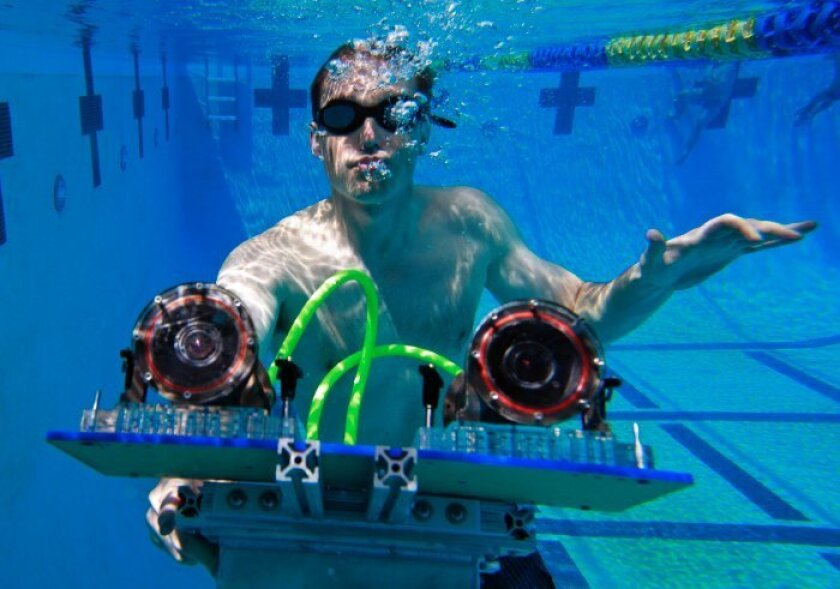 UC San Diego computer science Professor Ryan Kastner displays the underwater stereo camera system that he developed for producing 3D reconstruction of underwater objects.