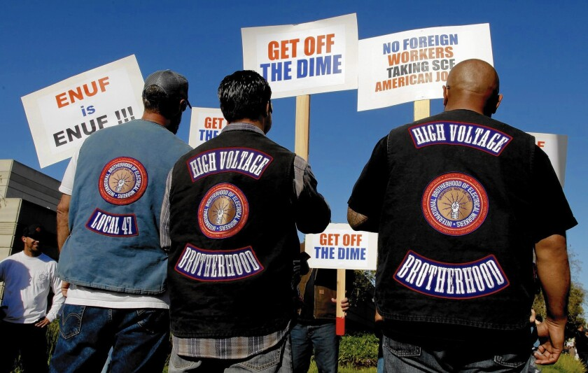 More than 300 members of the International Brotherhood of Electrical Workers rally Tuesday at the Southern California Edison offices in Irvine in support of their fellow Edison employees and protested what they say are unfair labor practices at the Southland's largest utility.