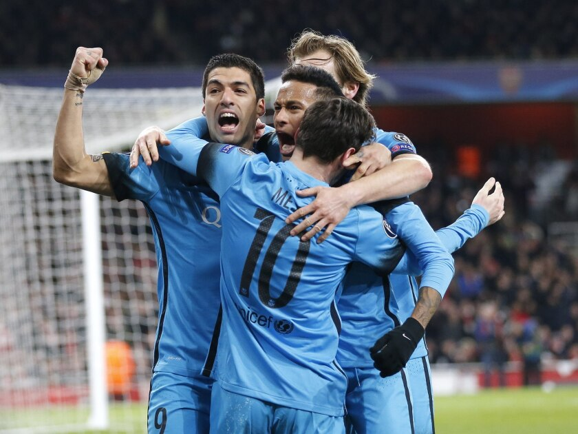 Barcelona players celebrate after Lionel Messi scored the opening goal during the soccer Champions League round of 16 first leg soccer match between Arsenal and Barcelona at the Emirates stadium in London, Tuesday, Feb. 23, 2016. (AP Photo/Frank Augstein)