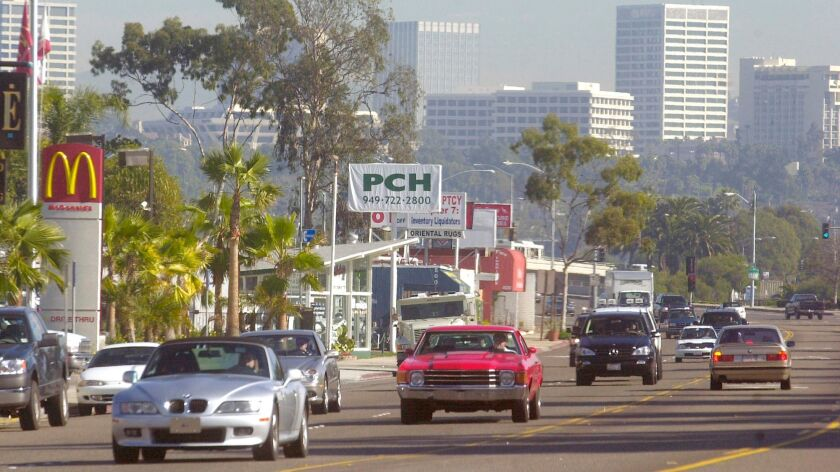 As seen in 2000, traffic travels along the roughly 1-mile section of West Coast Highway in Newport Beach known as Mariners' Mile.