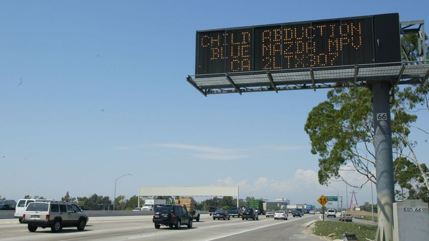 An Amber Alert freeway sign asks motorists to be on the lookout for a vehicle.