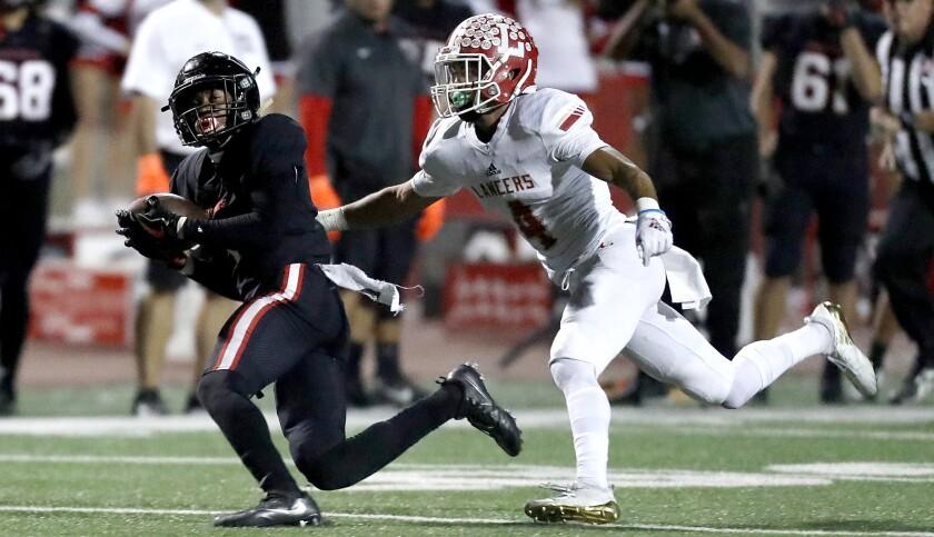 CORONA, CALIF. - NOV. 2, 2018. Centennial wide receiver Gary Bryant makes a catch against Orange Lut